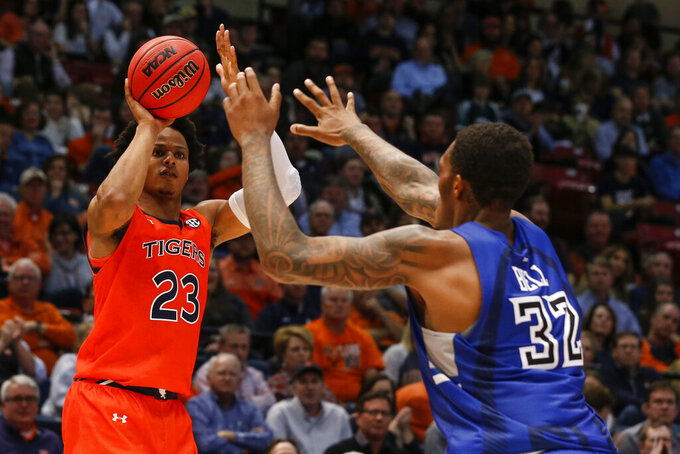 Auburn forward Isaac Okoro (23) prepares to shoot a three-point basket as Saint Louis forward Jimmy Bell Jr. (32) defends during the second half of an NCAA college basketball game Saturday, Dec. 14, 2019, in Birmingham, Ala. (AP Photo/Butch Dill)