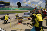 Grant Enfinger (98) pits during a NASCAR Truck Series auto race at Kansas Speedway in Kansas City, Kan., Saturday, July 25, 2020. (AP Photo/Charlie Riedel)
