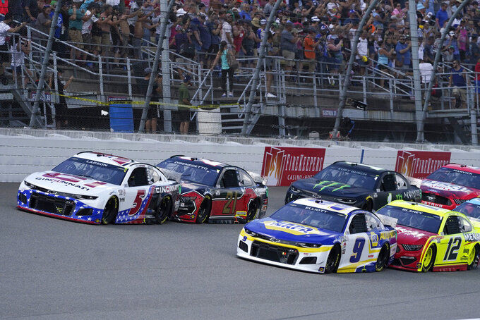 Kyle Larson (5) leads the field to start the NASCAR Cup Series auto race at Michigan International Speedway, Sunday, Aug. 22, 2021, in Brooklyn, Mich. (AP Photo/Carlos Osorio)