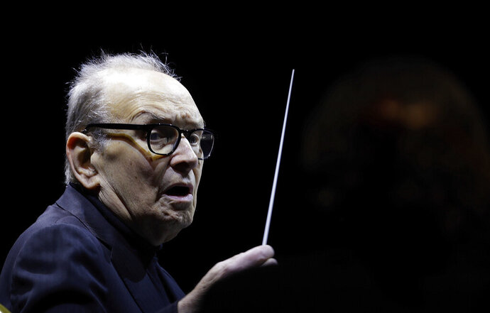 FILE - In this file photo dated Tuesday, March 6, 2018, Italian composer Ennio Morricone directs an ensemble during a concert of his