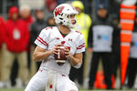 Wisconsin quarterback Jack Coan drops back to pass against Ohio State during the first half of an NCAA college football game Saturday, Oct. 26, 2019, in Columbus, Ohio. (AP Photo/Jay LaPrete)
