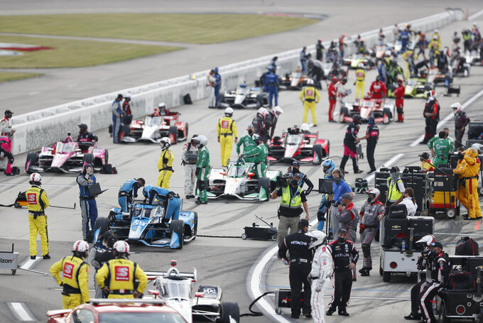 Drivers get set on pit road before an IndyCar Series auto race Saturday, July 18, 2020, at Iowa Speedway in Newton, Iowa. (AP Photo/Charlie Neibergall)