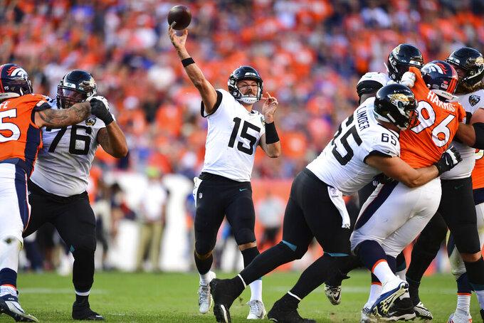 Jacksonville Jaguars quarterback Gardner Minshew II (15) passesr during the second half in the NFL game against the Denver Broncos in Denver Sunday, Sept. 29, 2019. (Eric Bakke via AP)