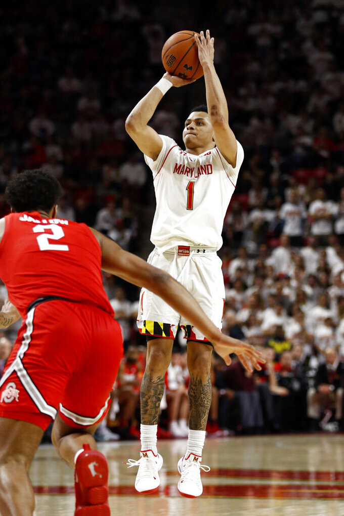 Maryland guard Anthony Cowan Jr. (1) shoots over Ohio State guard Musa Jallow in the second half of an NCAA college basketball game, Saturday, Feb. 23, 2019, in College Park, Md. Cowan contributed a game-high 19 points to Maryland's 72-62 win. (AP Photo/Patrick Semansky)