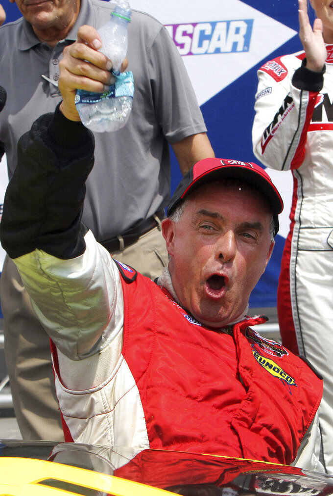 FILE - In this July 14, 2012, file photo, Mike Stefanik cheers after winning the NASCAR Whelen Modified Tour auto race at New Hampshire Motor Speedway in Loudon, N.H. The late Stefanik is a contender for NASCAR's 2021 Hall of Fame class, to be announced Tuesday, June 16, 2020.  (AP Photo/Jim Cole, File)