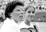 FILE - In this Sept. 10, 1971, file photo, Sixteen-year-old Chris Evert, right, talks with Billie Jean King after losing to King, 6-3, 6-2, at Forest Hills Tennis Stadium in New York. King and eight other women signed $1 contracts in September 1970 to form a women's tennis circuit. The WTA Tour now offers 55 events in 29 countries and $179 million in total prize money. (AP Photo/File)