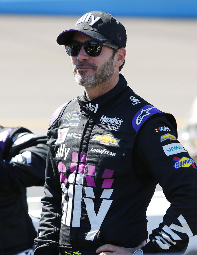 Driver Jimmie Johnson prior to the start of the NASCAR Cup Series auto race at ISM Raceway, Sunday, March 10, 2019, in Avondale, Ariz. (AP Photo/Ralph Freso)