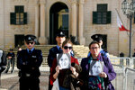 Daphne Caruana Galizia's Sister Mandy Mallia, right, protests outside the office of the Prime Minister at Castille, in Valletta, Malta, Tuesday, Dec. 3, 2019, as a delegation od European Union lawmakers is visiting the country after an investigation into the murder of leading investigative journalist Daphne Caruana Galizia implicated Prime Minister Joseph Muscat's chief of staff.  (AP Photo/Rene Rossignaud)