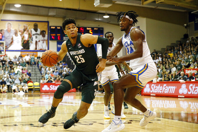Michigan State forward Malik Hall (25) tries to get around UCLA forward Jalen Hill (24) during the first half of an NCAA college basketball game Wednesday, Nov. 27, 2019, in Lahaina, Hawaii. (AP Photo/Marco Garcia)
