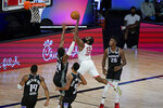 Houston Rockets' James Harden (13) shoots over Sacramento Kings' Buddy Hield (24) during the second half of an NBA basketball game Sunday, Aug. 9, 2020, in Lake Buena Vista, Fla. (AP Photo/Ashley Landis, Pool)