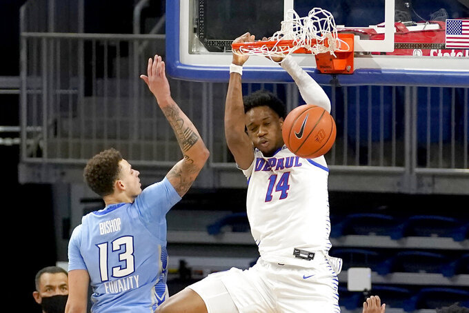 DePaul's Nick Ongenda (14) dunks over Creighton's Christian Bishop (13) during the first half of an NCAA college basketball game Saturday, Jan. 30, 2021, in Chicago. (AP Photo/Charles Rex Arbogast)