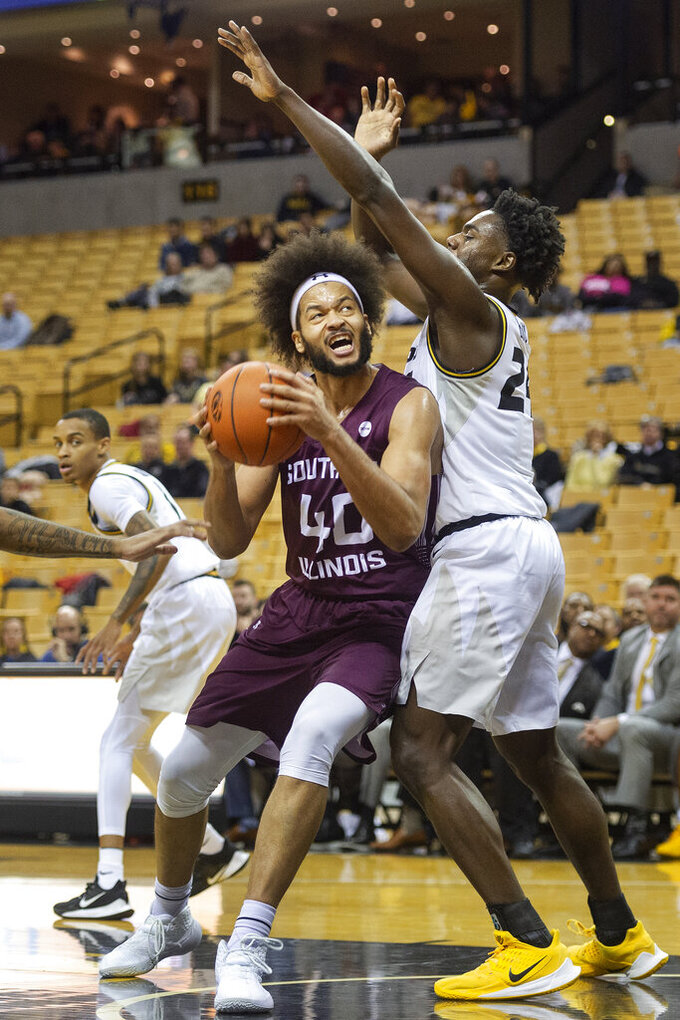 Southern Illinois' Barret Benson, left, shoots over Missouri's Kobe Brown, right, during the first half of an NCAA college basketball game Sunday, Dec. 15, 2019, in Columbia, Mo. (AP Photo/L.G. Patterson)
