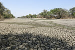 In this photo taken on Sunday, Oct. 27, 2019, a sun baked pool that used to be a perennial water supply is seen in Mana Pools National Park, Zimbabwe. An estimated 45 million people are threatened with hunger due to a severe drought that is strangling wide stretches of southern Africa. International aid agencies said they are planning emergency food deliveries for parts of South Africa, Zambia, Zimbabwe and other countries hard hit by a combination of low rainfall and high temperatures as summer approaches in the southern hemisphere. (AP Photo/Tsvangirayi Mukwazhi)