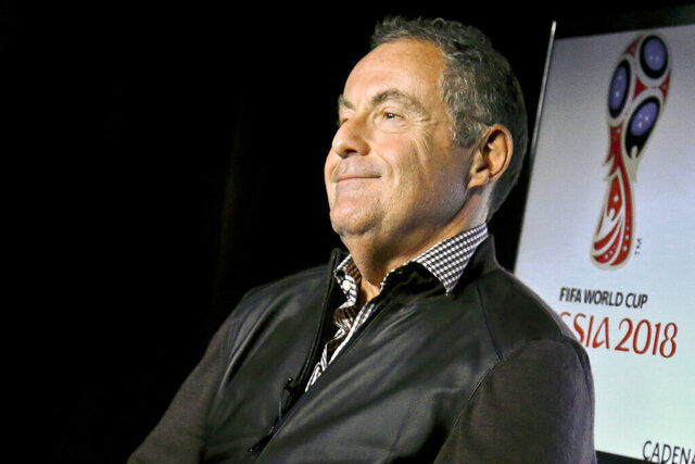 """FILE - In this Wednesday, May 16, 2018, file photo, Argentine sportscaster and Telemundo soccer broadcaster Andres Cantor smiles during an interview about his 2018 World Cup assignment, in New York. Cantor, famous for his screams of """"Goooooaaal!"""" during soccer broadcasts, has won the Colin Jose Media Award given annually by the U.S. National Soccer Hall of Fame. The award was announced Sunday night, Oct. 25, 2020. (AP Photo/Bebeto Matthews, File)"""