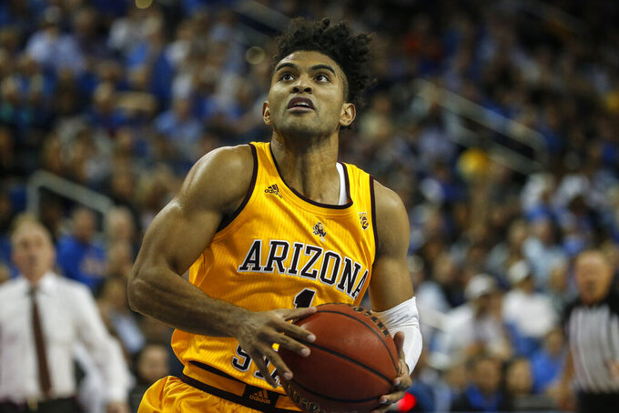 FILE - In this Feb. 27, 2020, file photo, Arizona State guard Remy Martin (1) drives to basket against UCLA during an NCAA college basketball game in Los Angeles. Martin has made The Associated Press 2020-21 preseason All-America team, announced Wednesday, Nov. 11. (AP Photo/Ringo H.W. Chiu, File)