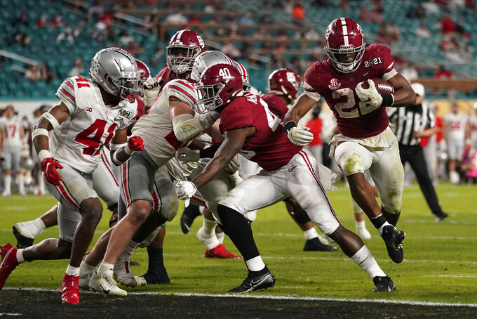 Alabama running back Najee Harris scores a touchdown against Ohio State during the second half of an NCAA College Football Playoff national championship game, Monday, Jan. 11, 2021, in Miami Gardens, Fla. (AP Photo/Lynne Sladky)