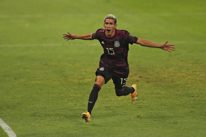 Mexico's Uriel Antuna celebrates scoring his side's opening goal during a Concacaf Men's Olympic qualifying championship semi-final soccer match in Guadalajara, Mexico, Sunday, March 28, 2021. (AP Photo/Fernando Llano)