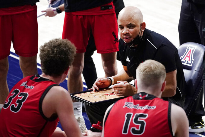 Eastern Washington head coach Shantay Legans talks to his players during the second half of an NCAA college basketball game against Arizona, Saturday, Dec. 5, 2020, in Tucson, Ariz. (AP Photo/Rick Scuteri)