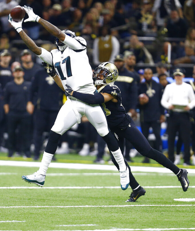 Philadelphia Eagles wide receiver Alshon Jeffery (17) pulls in a reception against New Orleans Saints cornerback Marshon Lattimore in the first half of an NFL divisional playoff football game in New Orleans, Sunday, Jan. 13, 2019. (AP Photo/Butch Dill)