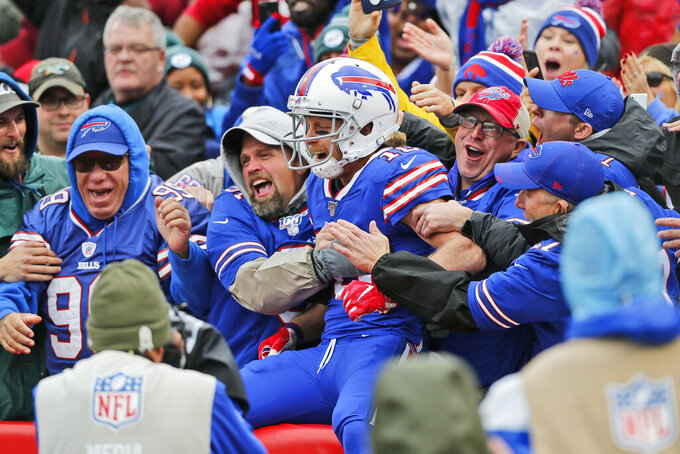 FILE - In this  Sunday, Oct. 27, 2019 file photo, Buffalo Bills' Cole Beasley celebrates his touchdown with fans during the first half of an NFL football game against the Philadelphia Eagles in Orchard Park, N.Y. New York is making an exception to its restrictions on large gatherings to allow about 6,700 fans to attend a Buffalo Bills home playoff game in January 2021 as long as all test negative beforehand.(AP Photo/John Munson, File)
