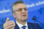 The head of the Robert Koch Institute, German national agency and research institute, responsible for disease control and prevention, Lothar Wieler, briefs the media during a press conference on the coronavirus and the COVID-19 disease situation in Berlin, Germany, Thursday, Jan. 14, 2021. ( John MacDougall/Pool via AP)
