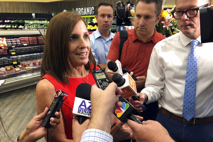 Sen. Martha McSally, R-Ariz., speaks to reporters about guns following a visit to a grocery store pharmacy in Phoenix, Thursday, Aug. 15, 2019. McSally and other Republicans looking ahead at tough races increasingly are looking for new ways to address anxieties about gun violence _ without running crosswise form a OGP base that sees gun restrictions as an infringement on the constitutional right to bear arms. (AP Photo/Jonathan J. Cooper)