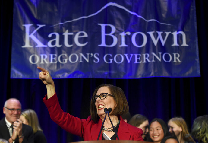 Gov. Kate Brown addresses the crowd after winning re-election in Portland, Ore., Tuesday, Nov. 6, 2018. (AP Photo/Steve Dykes)