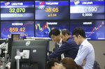 Currency traders watch monitors at the foreign exchange dealing room of the KEB Hana Bank headquarters in Seoul, South Korea, Friday, May 18, 2018. Asian stock markets trade marginally higher as U.S. and Chinese officials are holding a new round of talks to avert a trade war between the world's two biggest economies. (AP Photo/Ahn Young-joon)