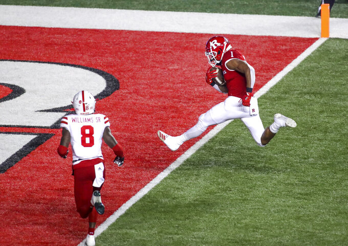 Rutgers running back Isaih Pacheco (1) crosses the goal line for a 33-yard touchdown during the second quarter of an NCAA college football game against Nebraska, Friday, Dec. 18, 2020, in Piscataway, N.J. (Andrew Mills/NJ Advance Media via AP)