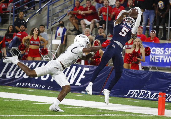 Fresno State Jalen Cropper, right, catches a touchdown pass against UNLV during the second half of an NCAA college football game in Fresno, Calif., Friday, Sept. 24, 2021. (AP Photo/Gary Kazanjian)