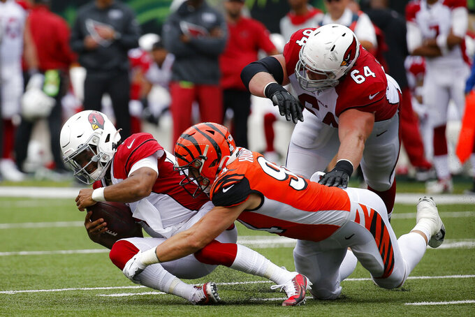 Arizona Cardinals quarterback Kyler Murray (1) is sacked by Cincinnati Bengals defensive end Sam Hubbard (94) in the first half of an NFL football game, Sunday, Oct. 6, 2019, in Cincinnati. (AP Photo/Frank Victores)