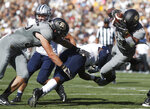 Colorado running back Beau Bisharat, left, pushes New Hampshire linebacker Quinlen Dean, center, as Colorado running back Travon McMillian dives into the end zone for a touchdown in the first half of an NCAA college football game Saturday, Sept. 15, 2018, in Boulder, Colo. (AP Photo/David Zalubowski)