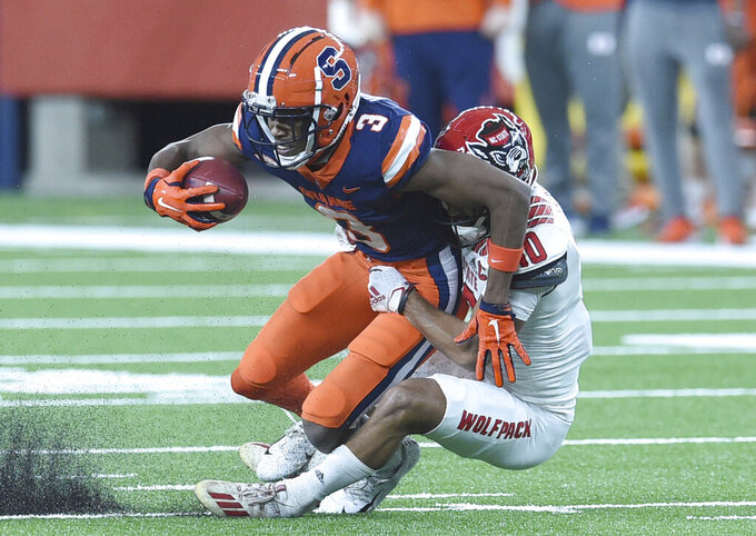 Syracuse wide receiver Taj Harris (3) gets tackled during the first half of an NCAA college football game against North Carolina State on Saturday, Nov. 28, 2020, at the in Syracuse, N.Y. (Scott Schild /The Post-Standard via AP)