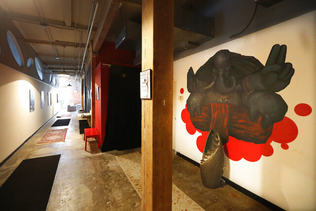 In this April 1, 2020, photo, the long hallway inside Naveed Abidi's Bikram Yoga West is empty of members after being closed by the city last week, tipped off by several residents who disagreed with it being an essential health and wellness center in Chicago.