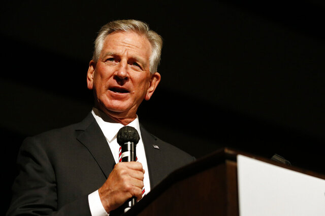 Former Auburn football coach Tommy Tuberville speaks to supporters, Tuesday, July 14, 2020, in Montgomery, Ala. Tuberville's quest for a seat in the U.S. Senate is powered by the reputation he gained as Auburn University's football coach, where he led the team to an undefeated season. But in the years since, the Republican has been mired in business failings, a lawsuit and even a questionable charity that raises money but gives very little away. (AP Photo/Butch Dill)
