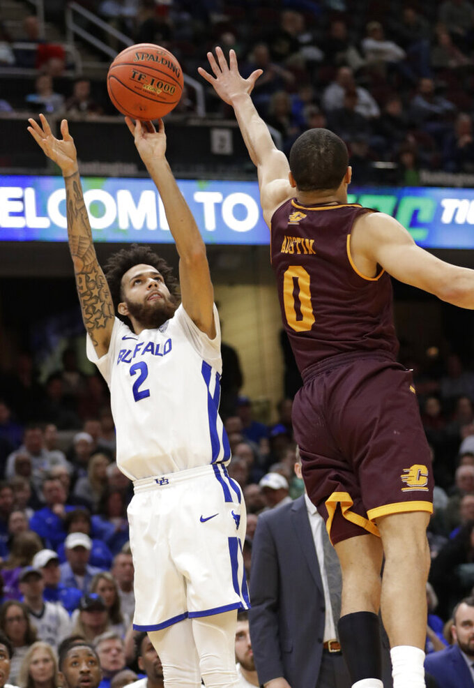 Buffalo's Jeremy Harris (2) shoots over during the second half of an NCAA college basketball game in the semifinals of the Mid-American Conference men's tournament Friday, March 15, 2019, in Cleveland. Buffalo won 85-81. (AP Photo/Tony Dejak)