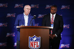 Atlanta Falcons President and CEO, Rich McKay, left, and Troy Vincent, Executive Vice President of Football Operations for the NFL, right, speak to the media during the NFL football owners meeting on Wednesday, May 22, 2019, in Key Biscayne, Fla. (AP Photo/Brynn Anderson)