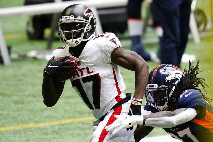 Atlanta Falcons wide receiver Olamide Zaccheaus (17) makes the catch against Denver Broncos cornerback Horace Richardson (27) during the first half of an NFL football game, Sunday, Nov. 8, 2020, in Atlanta. (AP Photo/Brynn Anderson)