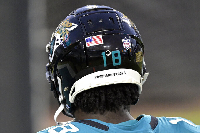 The helmet of Jacksonville Jaguars wide receiver Chris Conley has the name Rashard Brooks on the back of his helmet to bring attention to social justice as he walks on the field before an NFL football game, Thursday, Sept. 24, 2020, in Jacksonville, Fla. (AP Photo/Phelan M. Ebenhack)
