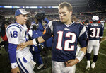 FILE - In this Nov. 5, 2006 file photo New England Patriots quarterback Tom Brady (12) congratulates Indianapolis Colts quarterback Peyton Manning (18) after Manning and the Colts defeated the Patriots 27-20 in their NFL football game in Foxborough, Mass. Only the Manning brothers keep Brady from dominating the decade even more with Peyton beating him in an AFC championship game and Eli's last-minute touchdown throw denying the Patriots perfection in the 2007 season. (AP Photo/Winslow Townson, file)