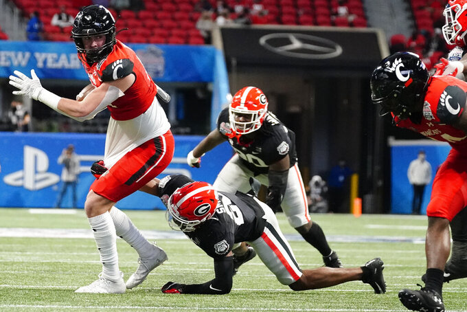 Cincinnati tight end Josh Whyle (81) runs against Georgia during the first half of the Peach Bowl NCAA college football game, Friday, Jan. 1, 2021, in Atlanta. (AP Photo/Brynn Anderson)