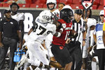 Central Florida defensive back Quadric Bullard (37) attempts to tackle Louisville running back Jalen Mitchell (15) during the second half of an NCAA college football game in Louisville, Ky., Friday, Sept. 17, 2021. (AP Photo/Timothy D. Easley)