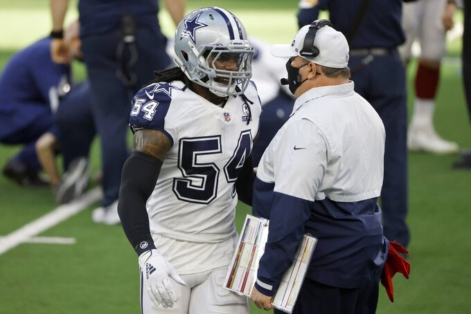 Dallas Cowboys linebacker Jaylon Smith (54) talks with head coach Mike McCarthy, right, during an injury time out in the first half of an NFL football game against the Washington Football Team in Arlington, Texas, Thursday, Nov. 26, 2020. (AP Photo/Ron Jenkins)