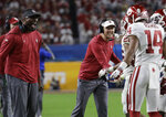 Oklahoma head coach Lincoln Riley, center, congratulates wide receiver Charleston Rambo (14) after Rambo scored a touchdowns, during the second half of the Orange Bowl NCAA college football game against Alabama, Saturday, Dec. 29, 2018, in Miami Gardens, Fla. (AP Photo/Lynne Sladky)