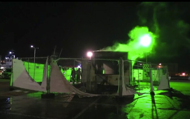 In this image made from video, a burnt out COVID-19 testing center is seen after being set on fire in Urk, 80 kilometers (50 miles) northeast of Amsterdam, Saturday, Jan. 23, 2021. Dutch police have clashed with protesters demonstrating against the country's lockdown in the capital, Amsterdam and the southern city of Eindhoven. The unrest comes a day after rioting youths protesting on the first night of the country's curfew torched a coronavirus testing facility in Dutch fishing village Urk. (Pro News via AP)