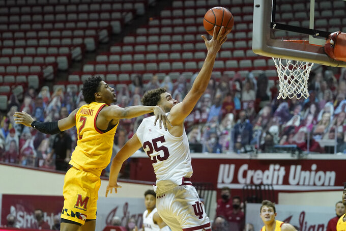 Indiana forward Race Thompson (25) shoots against Maryland guard Aaron Wiggins (2) during the second half of an NCAA college basketball game, Monday, Jan. 4, 2021, in Bloomington, Ind. (AP Photo/Darron Cummings)