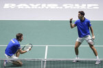 France's Nicolas Mahut, right, and Pierre-Hugues Herbert celebrate a point against Japan's Ben McLachlan and Yasutaka Uchiyama, during their Davis Cup double tennis match in Madrid, Spain, Tuesday, Nov. 19, 2019. (AP Photo/Manu Fernandez)