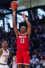 North Carolina State guard C.J. Bryce (13) shoots in the first half of an NCAA college basketball game against Georgia Tech Saturday, Jan. 25, 2020, in Atlanta. (AP Photo/Danny Karnik)