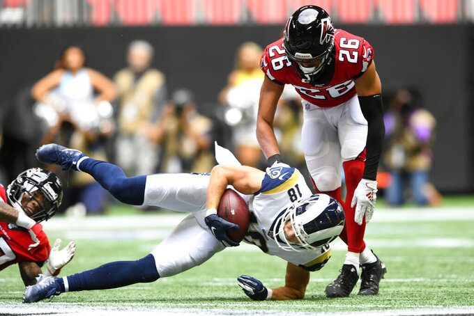 Los Angeles Rams wide receiver Cooper Kupp (18) makes the catch ahead of Atlanta Falcons cornerback Isaiah Oliver (26) during the first half of an NFL football game, Sunday, Oct. 20, 2019, in Atlanta. (AP Photo/John Amis)