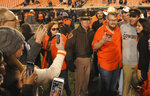 Oklahoma State head coach Mike Gundy celebrates with fans following the 45-41 upset over West Virginia at the end of an NCAA college football game in Stillwater, Okla., Saturday, Nov. 17, 2018. (AP Photo/Brody Schmidt)